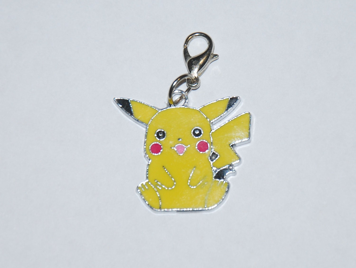 I have this adorable Pokemon Pikachu clip charm.