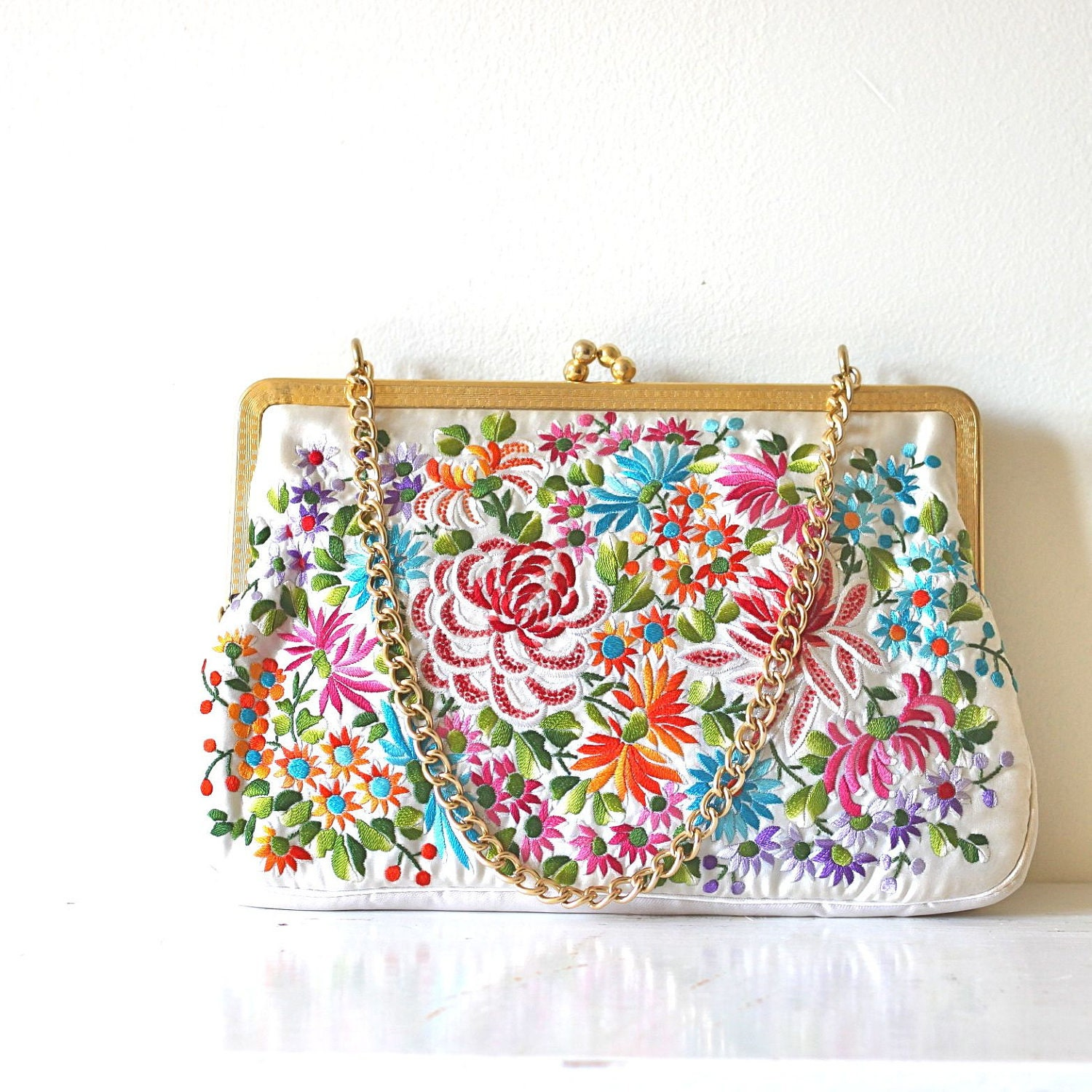 vintage FOLK FLORL satin clutch.