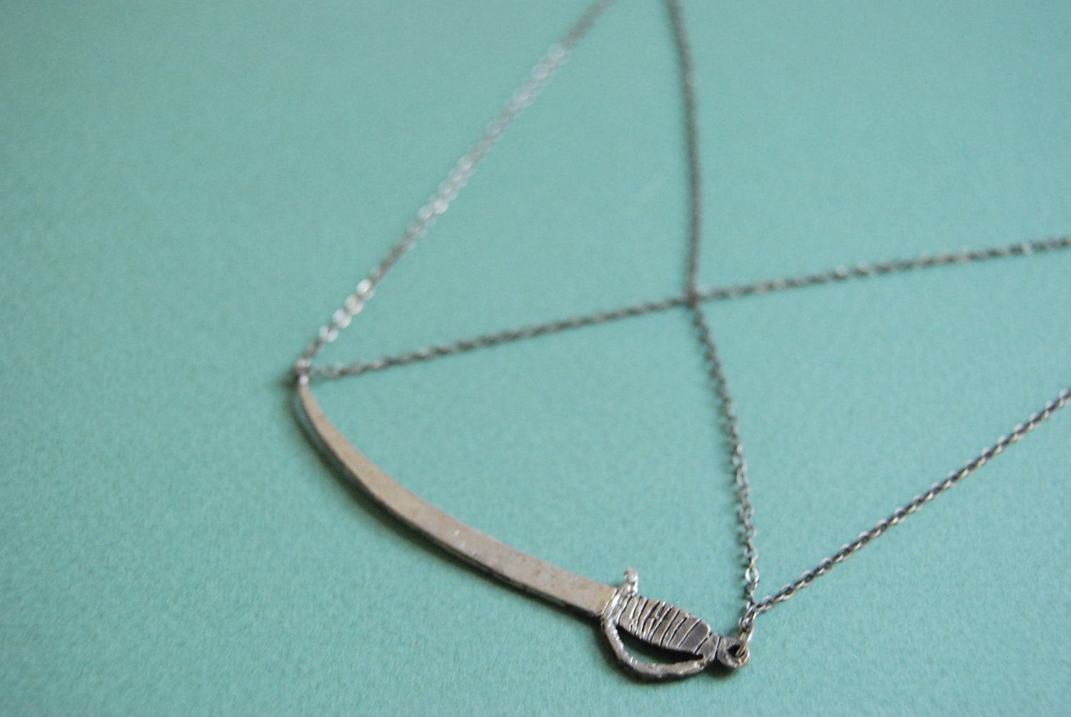 Crossed chain sword necklace