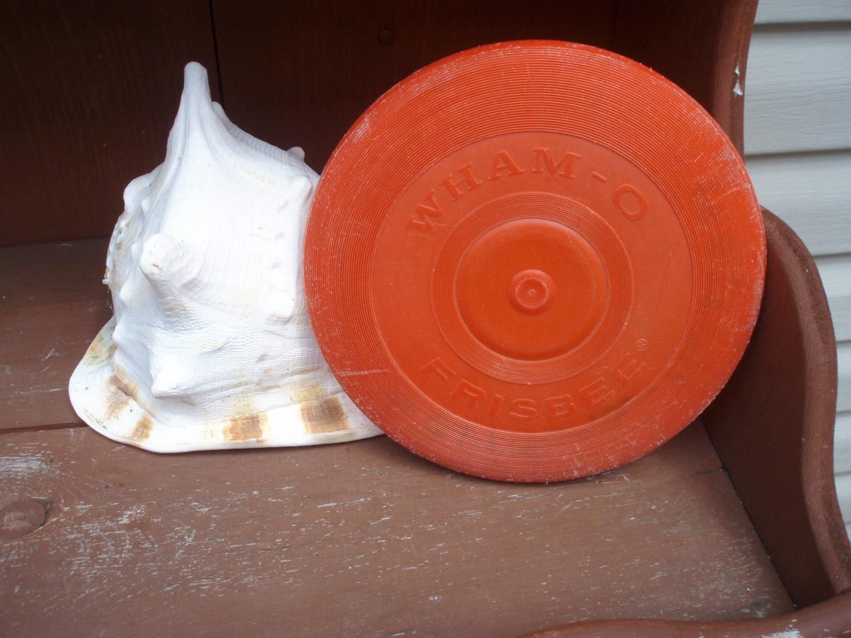 red plastic whamo frisbee wham o frisbee