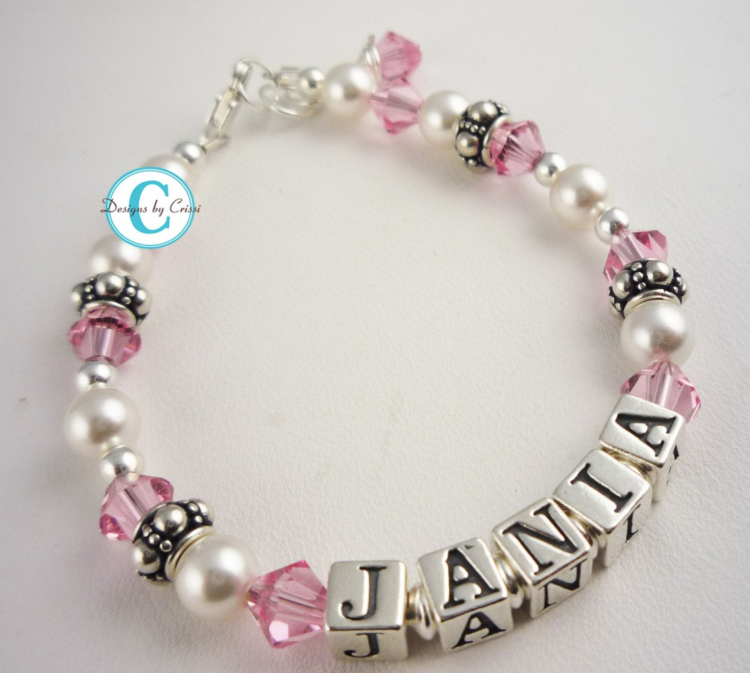 Beautiful jewelry for babies and children in silver and gold for girls and boys of all ages. Infant and baby bracelets, babies pearl bracelets, little girl bracelets, children's name bracelets, lockets for girls, screw back earrings, huggie hoop earrings, childrens jewelry boxes, christening bracelets and christening pins, and more. Free Shipping.