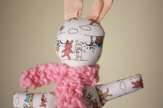 little rabbit whit knitted pink scarf