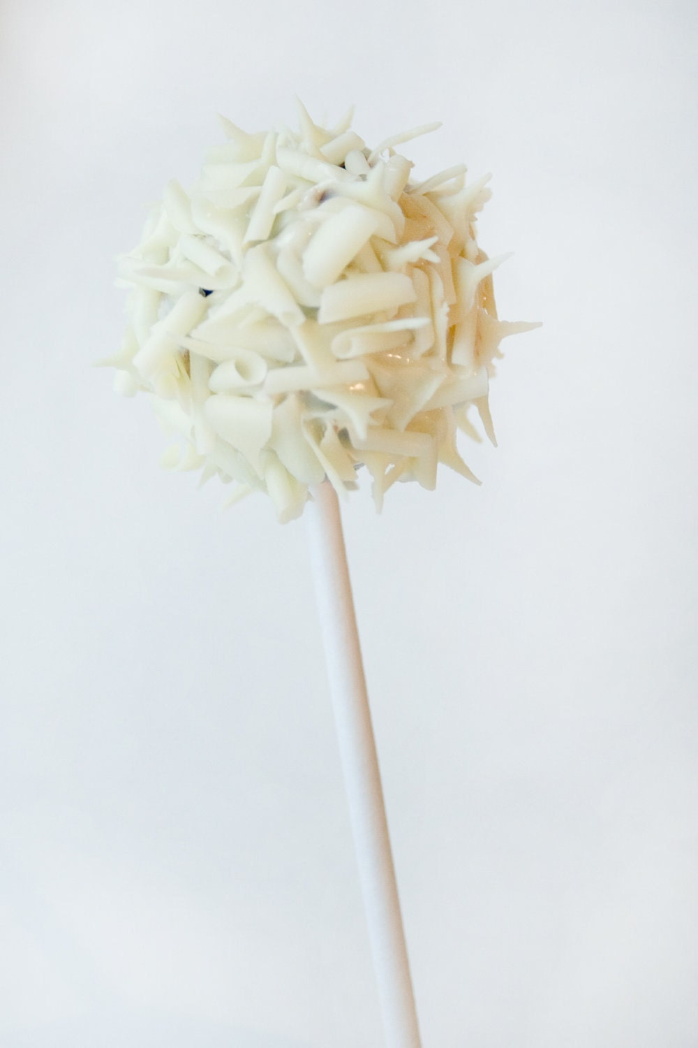 Rich homemade chocolate truffle pop coated in white chocolate and white chocolate curls - 6 - Trufflicious