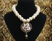 Pearl necklace with steampunk pendant made from vintage watch parts and a filigree mount
