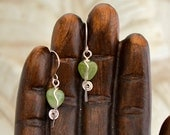 "green heart dangle earrings.    925 Sterling silver wire wrapped glass beads. ""unbroken hearts"""
