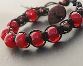 Chocolate Covered Cherries, artisan lampwork yummy red, wrapped in leather bracelet