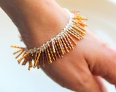 fringe bracelet iridescent bugle beaded bracelet. lustrous shimmer beaded wire wrapped tan purple bugle beads uniquenecks beaded jewelry
