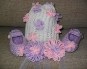 RESERVED. 3-6 months set includes: White hat with pink and purple flowers, purple babyjanes, and two flower tie-ons