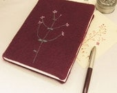 handmade felted wool notebook in purple decorated with blooming branch - lewin