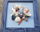 Framed Maine Seashell and Beach Stone Collage on Blue Canvas - timeandtidemaine
