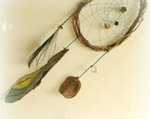 Baby mobile - dream catcher apache tear shaped with painted tree bark and a peacock feather