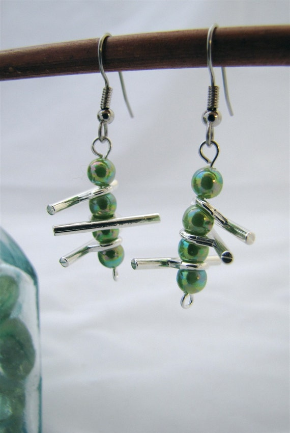 Green Ladder Earrings: green glass alternating with silver-plated bars that swing wildly