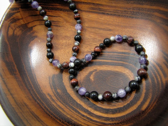 Geologic Ages Necklace: 6mm red tiger eye, black obsidian, and chevron amethyst beads, each separated by a 4mm silkstone bead