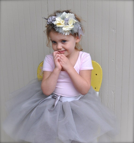 Short fluffy ivory girls tutu. Featured in Martha Stewart's Flower Girl layout.