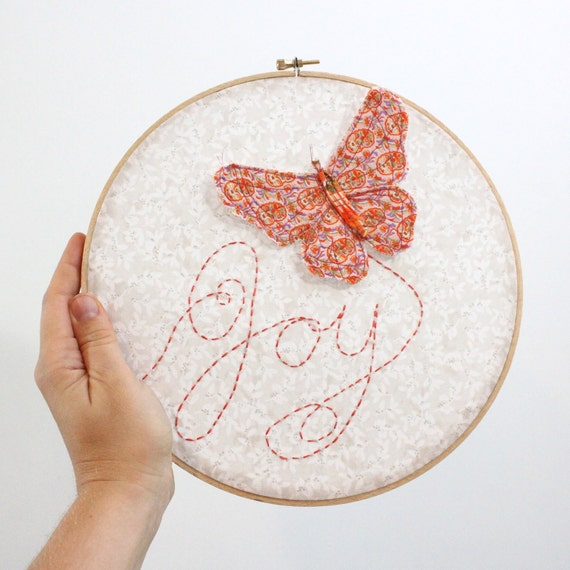 "Butterfly Embroidery Hoop - Joy Flutters In - hand embroidered 10"" wall hanging in peach, coral pink, beige, white, and lilac"