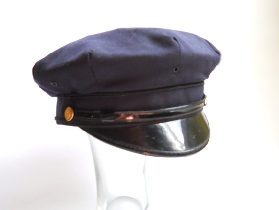 2c03c137bf3 The first hat was the blue Policeman s hat worn by my father. I thought it  made him look a giant and one dared not dispute his authority.