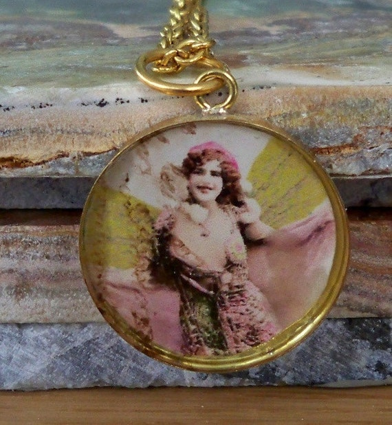 Handmade Vintage Green Winged Fairy in Ice Resin necklace