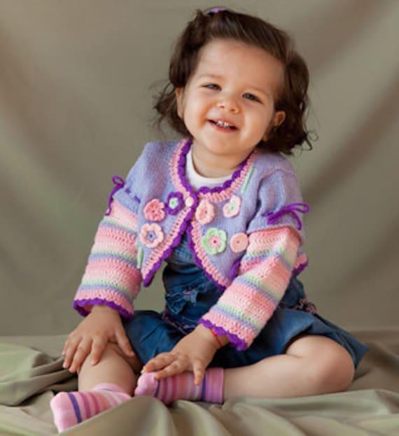 دست زیبا بچه بولرو با گل بهار کشباف