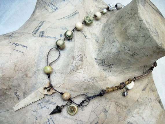 Work is Love. Ceramic rounds and bone saw rustic gypsy assemblage necklace.