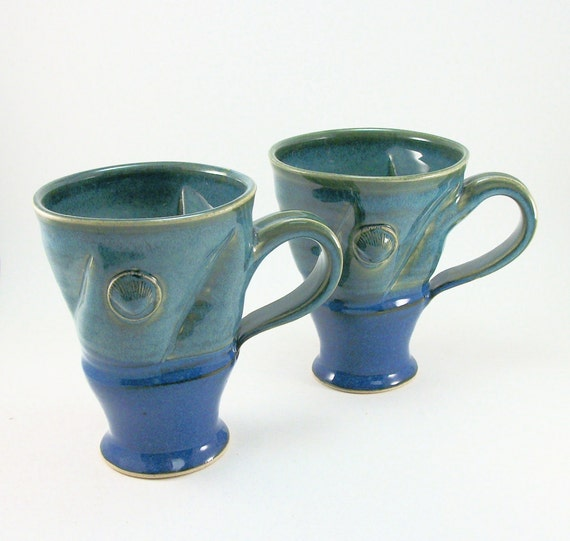 pair of fantastic blue-green mugs with shells
