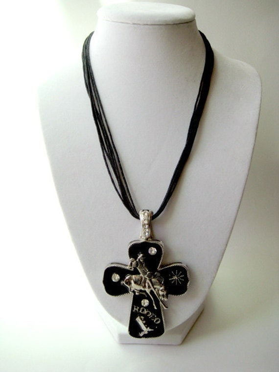 RIDE 'EM COWGIRL: Rodeo cowgirl magnetic cross pendant on leather cord necklace