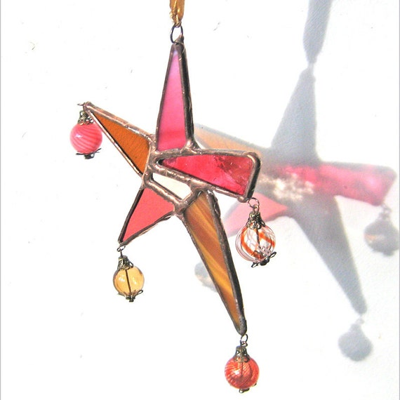 Stained Glass Carnival Star Suncatcher in pinks and cinnamon and caramel