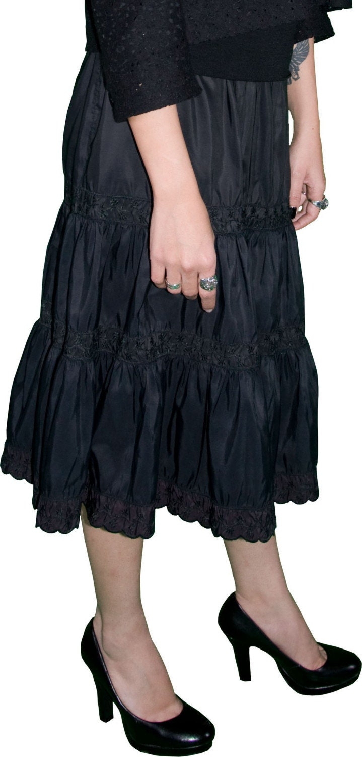 black vintage peasant skirt with floral accents