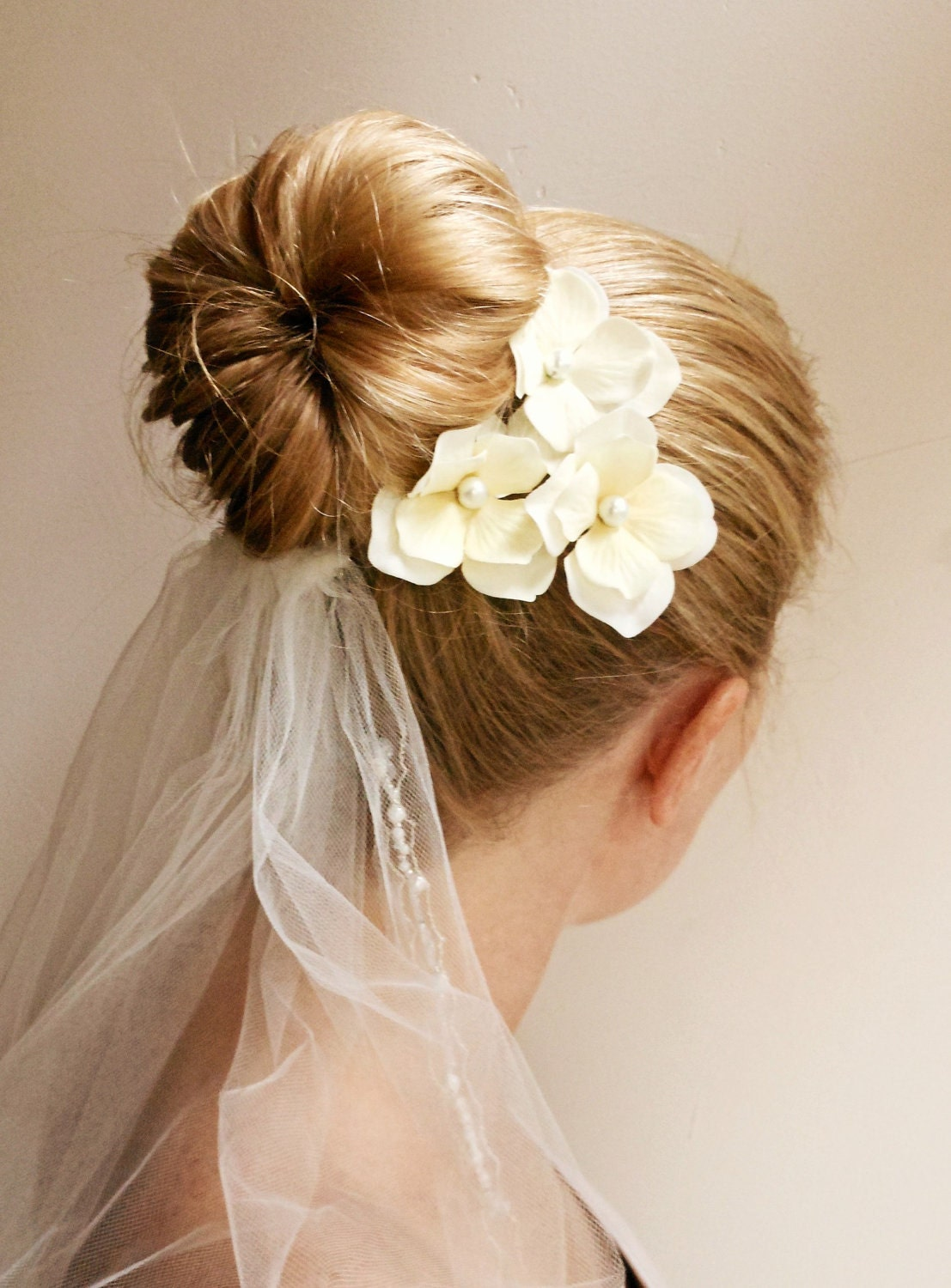 ponytails and buns – simple and easy wedding hairstyles for long