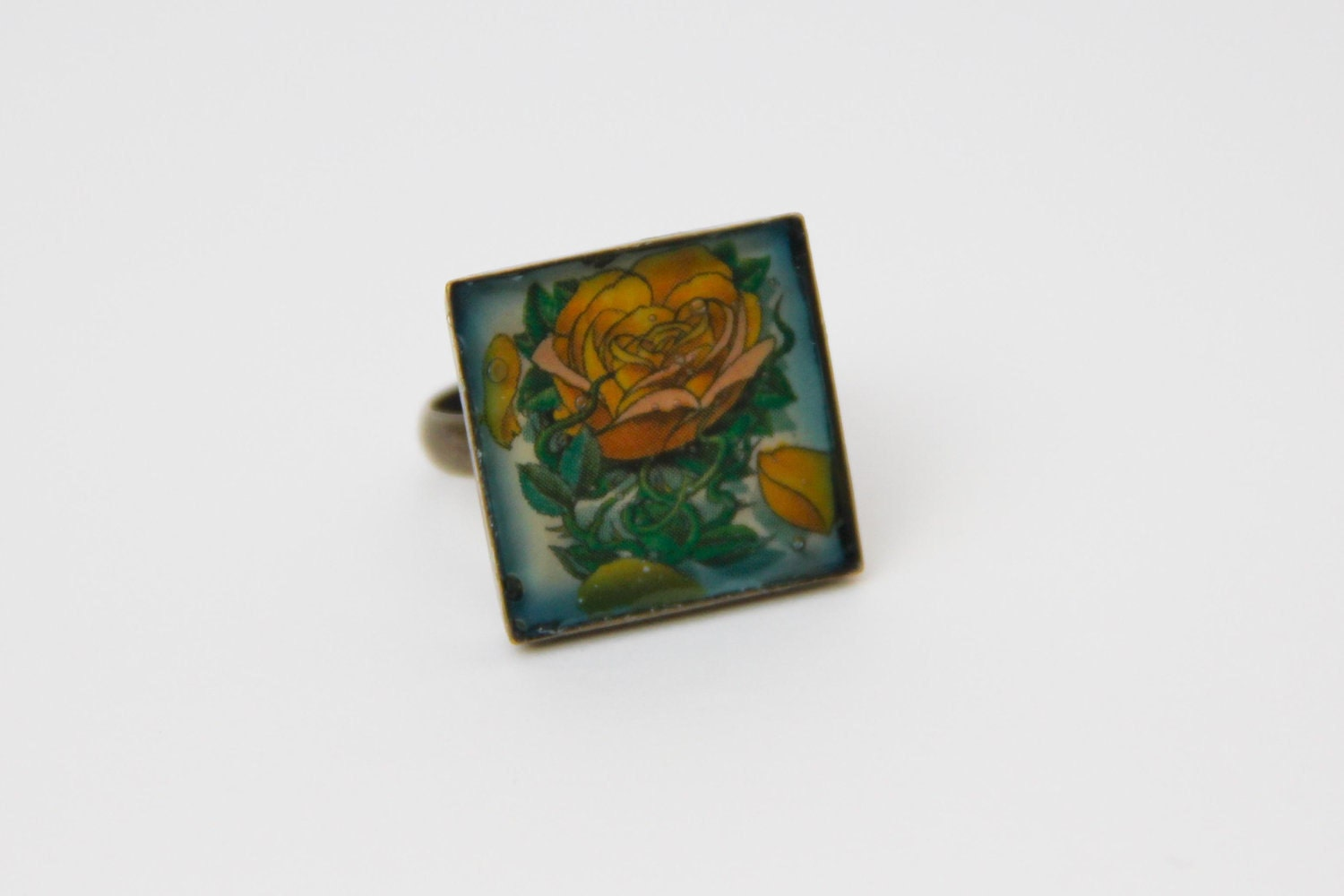 This is a tattooed ring He has a nice old school rose image on it the ring