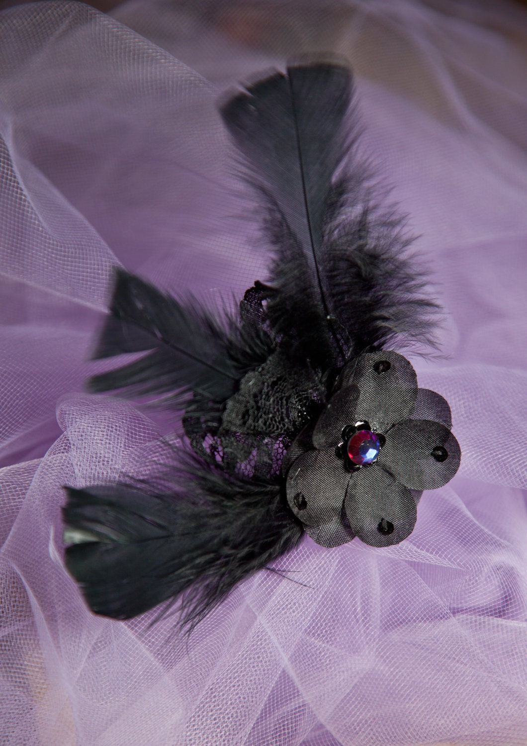 black Victorian-inspired floral barrette with feathers, lace, and iridescent stone